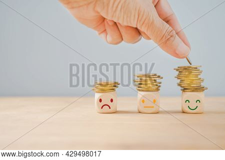 Hand Placing Golden Coin On The Highest Stack Of Coins, Saving Money, Deposit, Wealthy, Profit Conce