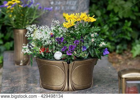 Flowerpot With Colourful Flowers On A Gravestone