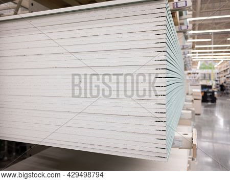 A Stack Of Drywall Sheets In A Hardware Store. Construction And Renovation Concept. Copy Space.