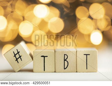 Hashtag Tbt Throwback Thursday Written With Wooden Cubes With Shiny Bokeh Background, Social Media C