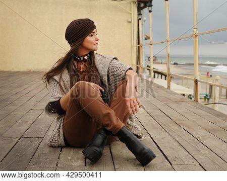 Beautiful brunette woman portrait dressed in jersey turban, autumn authentic fashion concept