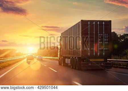 Scenic Front View Big Long Heavy Semi-treailer Truck With Sea Shipping Container Driving Highway Dra
