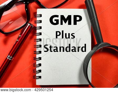 Quality Assurance Concept.text Gmp Plus Standard Writing On Notebook With Magnifying Glass,glasses A
