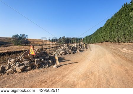 Dirt Road Route Improvements With Shale Stone Piles For Grader Machine To Improve Road Surface In Ru
