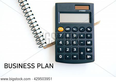 Calculator And Notebook Isolated On White Background. Concept Of Family Budget And Payment Of Taxes,