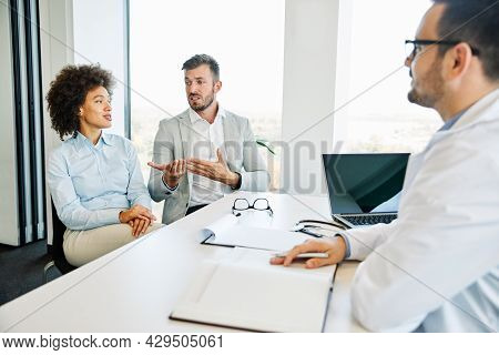 Young Couple Having Consultationd And Arguing In A Doctors Office