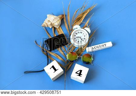 Calendar For August 14 : The Name Of The Month Of August In English, Cubes With The Number 14, A Dry