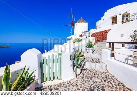 Oia - Santorini, Greece. Amazing Whitewashed City On Thira Island, Greek Cyclades, Aegean Sea. Holid