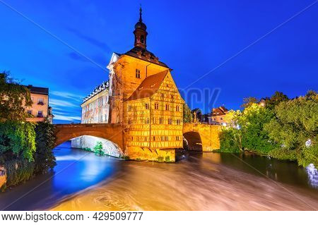 Bamberg, Germany. Old Town With Regnitz River At Night, Franconia Travel Place In Bavaria.