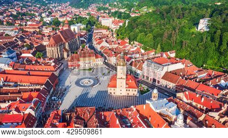 Brasov, Romania - Aerial Drone View Of Council Square With Black Church, Medieval Downtown, Transylv