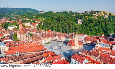 Brasov, Romania - Aerial Sunrise Drone View Of Main Square, White Tower And Black Church, Travel In