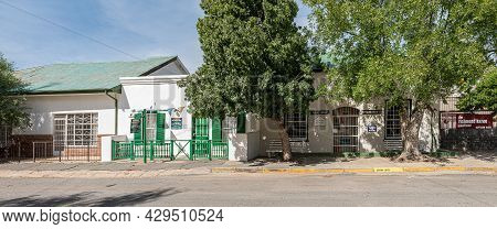 Richmond, South Africa - April 2, 2021: A Street Scene, With The Richmond Trading Post And Public Li