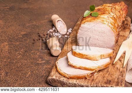 Homemade Baked Pork Tenderloin On Stone Concrete Background