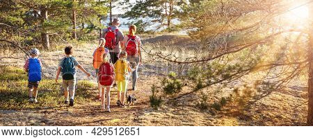 Big Family With Backpacks On The Nature Near The Sea. Concept Of The Family Hiking And Children's Sc