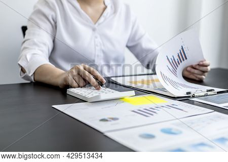 Financial Accountants Are Checking Documents From The Finance Department, Verifying Company Financia