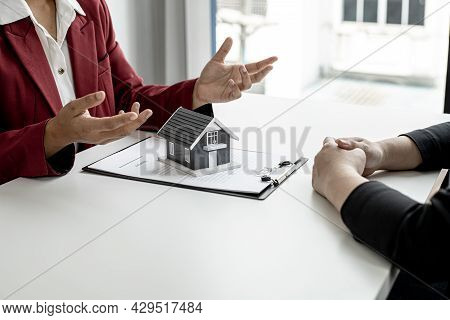An Employee Of The Rental Company Was Explaining To Tenants In Detail The Rental Agreement Before Ag