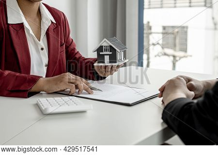 The Landlord Is Describing The Home And The Rental Agreement To The Tenant Before Agreeing To Sign T