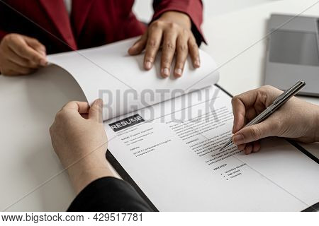 The Job Applicant Is Checking The Resume With The Human Resources Department Before Taking The Job I