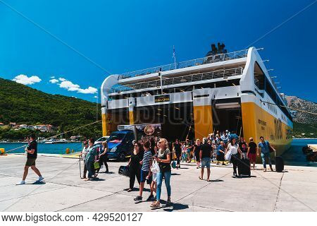 Poros, Cephalonia Island, Greece - July, 17 2019: Disembarkation Of Cars And Passengers From Ferry B