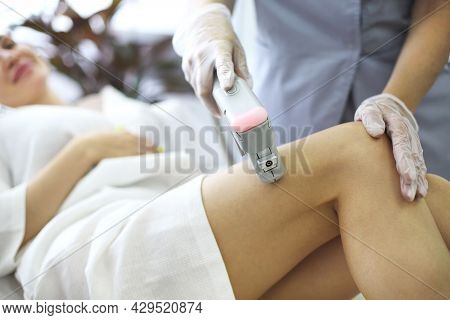 Hair Removal Procedure. Cropped Shot Of Young Fit Blonde Woman Client Receiving Laser Hair Removal P