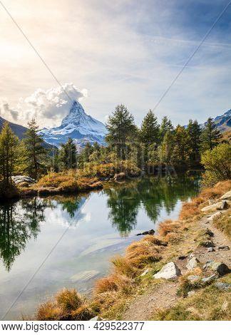 Famous alpine peak Matterhorn refleced in a pond in Swiss Apls