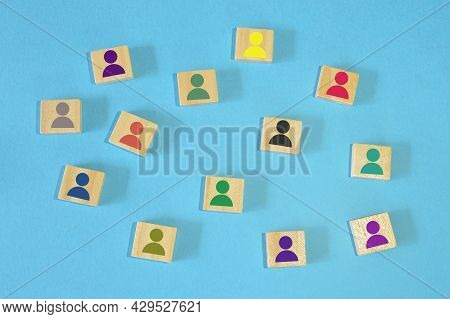 Different Color Of Human Symbol On Wooden Blocks. Different Skills And Different Abilities Concept.