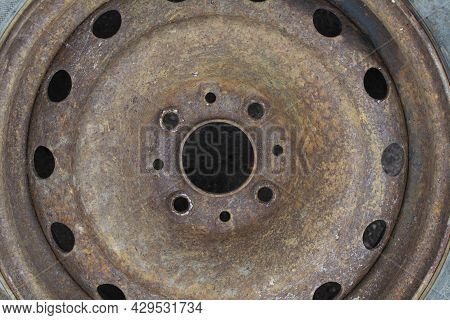 Old Rusty Car Stamped Wheel Disc. Metal Corrosion Texture