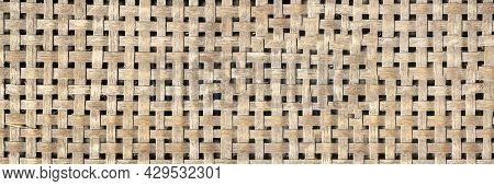 Wood Grain Background Bamboo Art. Texture Background Of Bamboo Basketry. Panoramic Banner. Selective