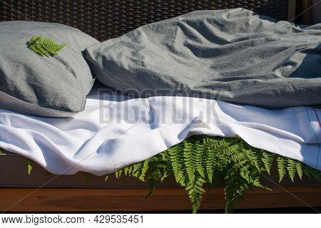 Wood Fern Leaves Under Bedsheet. Sleeping On Fern Leaves. Tradicional Anti-arthritic Remedy.