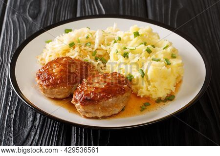 Pork Fried Meat Balls With Mashed Potatoes And Sauerkraut Close-up In A Plate On The Table. Horizont
