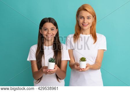 Happy Adoptive Family Of Adopted Daughter Child And Woman Mother Smile Holding Houseplants, Adoption