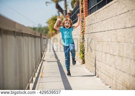 Excited Energetic Boy Child Scream Running On Summer Promenade, Excitement