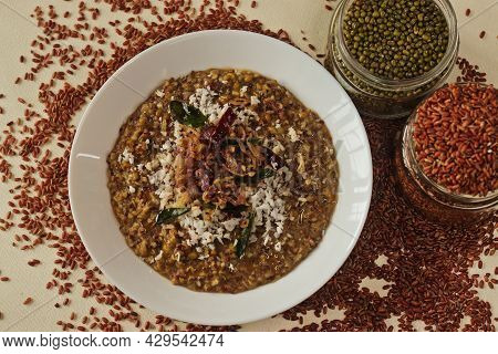 Porridge Or Gruel Made Of Navara Rice, Mung Beans And Fenugreek Seeds Sprinkled With Fresh Grated Co