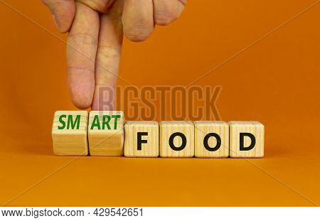 Smart Food Symbol. Doctor Turns Cubes And Changes Words 'food' To 'smart Food'. Beautiful Orange Bac