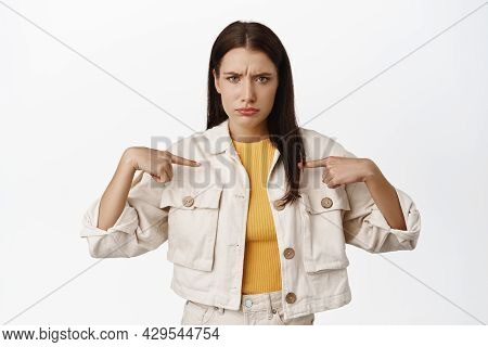 Why Me. Upset Silly Woman, Furrow Eyebrows And Pointing At Herself, Feel Unfair Or Hurt, Being Offen