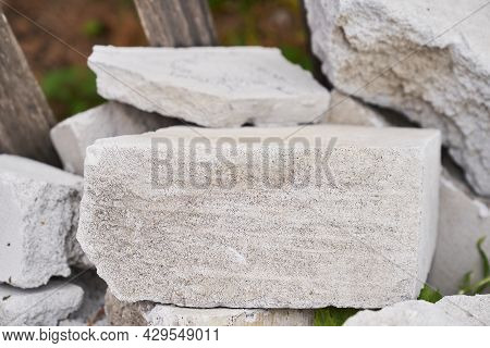 Stone Podium. The Pedestal Is Made Of Natural Stone Of Gray Color, On A Stone Background. To Demonst