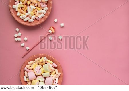 Colorful Marshmallows On A Pink Dish Isolated On A Pink Background.scattered Marshmallows Fluffy Mar