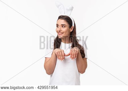 Portrait Of Funny And Cute, Playful Adult Girl In T-shirt And Rabbit Ears, Look Away With Amused Hap