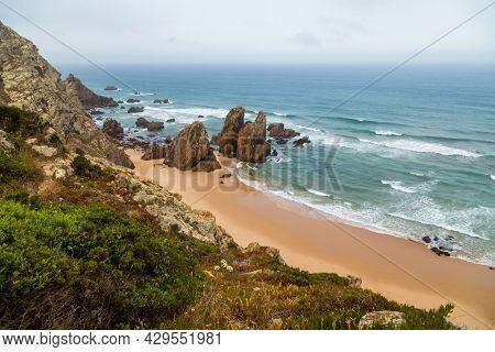 View of Praia da Ursa atlantic coast rocky cliff beach at Cabo da Roca, Sintra, Lisbon. Portugal