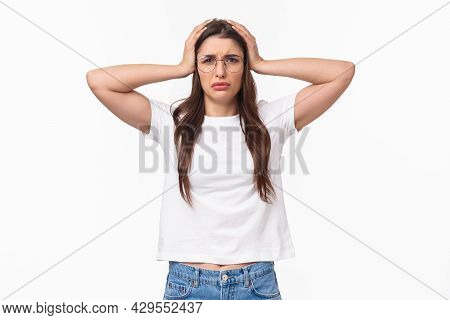 Waist-up Portrait Of Troubled Female Student Have Big Problem, Grab Head Frowning And Grimacing Faci
