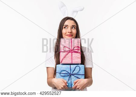 Celebration, Holidays And Presents Concept. Portrait Of Silly And Cute, Lovely Young Girl In Rabbit