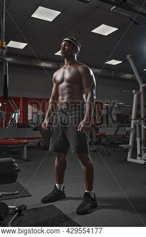 African American Man With Naked Muscular Torso Posing In Gym During Training. Sport Healthy Lifestyl