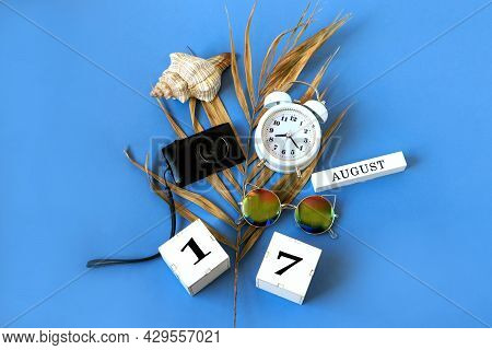 Calendar For August 17 : The Name Of The Month Of August In English, Cubes With The Number 17, A Dry