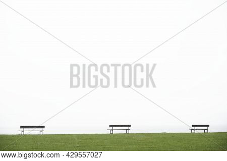 Lonely Empty Seats In Open Tranquil Landscape By The Sea For Mindfulness And Meditation