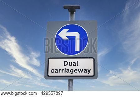 Dual Carriageway Direction Motorway Road Sign Against Sky