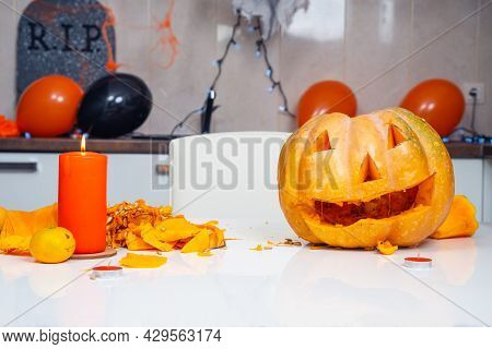 Someone Is Decorating Apartment For Halloween Holiday Party, So They Made Pumpkin Lantern, Placed Ca