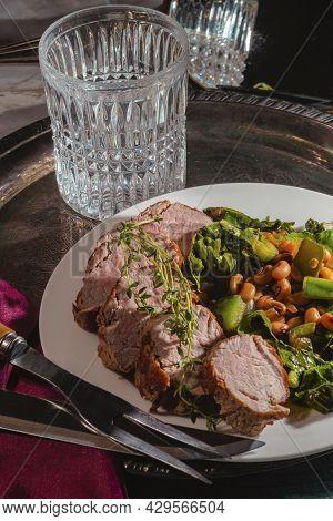 Roasted Pork Tenderloin With Collard Green Black Eyed Pea Salad