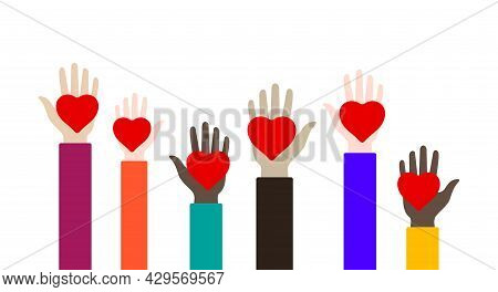 Childrens Hands With Red Hearts Raised In Different Colors. Charity, Volunteering And Donating Conce