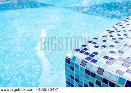 Corner Edge Of A Swimming Pool In A Sunny Day