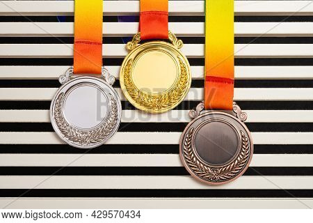 Set Of Gold Silver And Bronze Award Medals Horizontal Composition